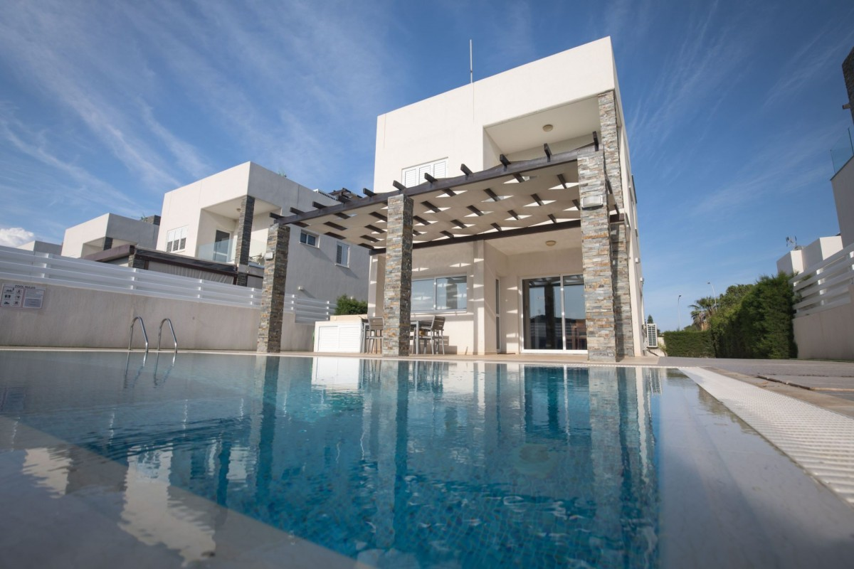 The photo is showcasing Anemoni Villa in Protaras, the pool and the exterior area of the villa.